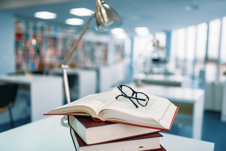 books-and-glasses-on-table